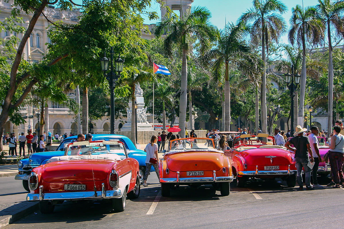 Vintage cars waiting for (rather rich) tourists in Havana