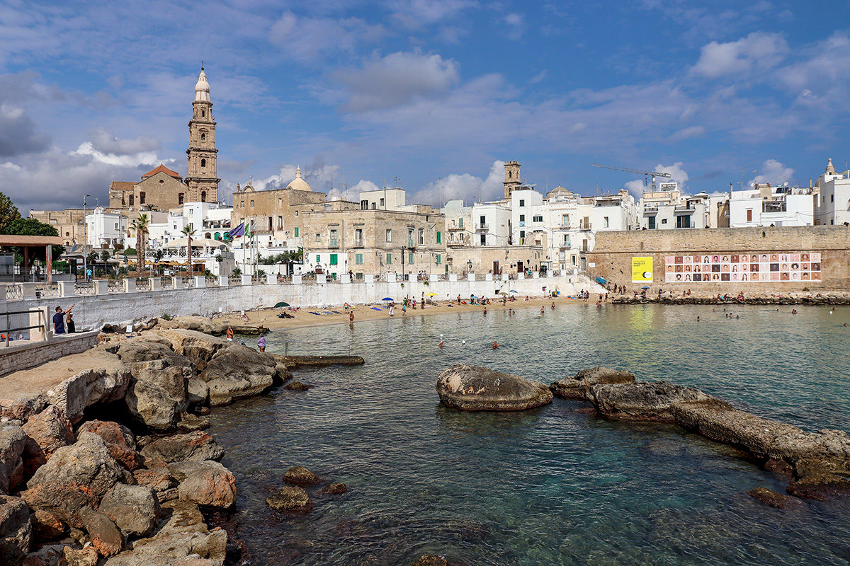 A view to Monopoli's public beach and old town
